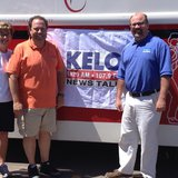 Rita Nelson and Ken Versteeg of Community Blood Bank are joined by KELO's Greg Belfrage at the 13th Annual Hog Wild Blood Drive - KELO