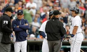 Detroit manager Jim Leyland (left) talking with an umpire after Miguel Cabrera (far right) was ejected during Sunday's 12-4 win over Philadelphia.  Cabrera was ejected after contesting a few pitches while batting in the 3rd inning.