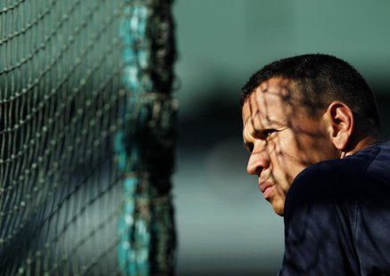 New York Yankees' Alex Rodriguez awaits his turn in the batting cage prior to their MLB American League baseball game against the Oakland At