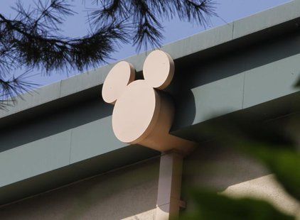A rain spout stylized with the outline of Disney character Mickey Mouse is seen on a building at The Walt Disney Co. studios in Burbank, Cal