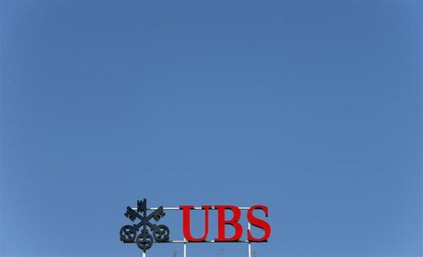 The logo of Swiss bank UBS is seen on an office building in Zurich July 22, 2013. REUTERS/Arnd Wiegmann