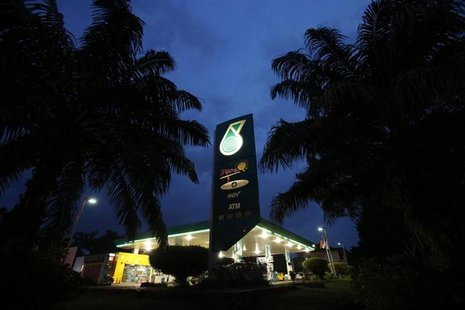 The Petronas logo is seen at one of its petrol outlets in Putrajaya outside Kuala Lumpur December 8, 2012.REUTERS/Bazuki Muhammad