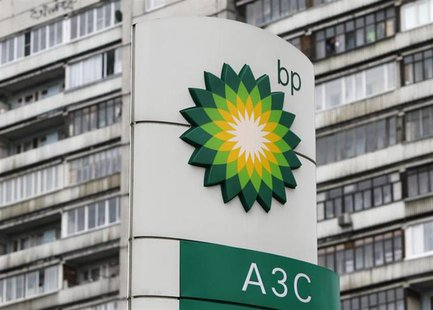 A BP logo is seen in front of an apartment block near a petrol station in Moscow October 22, 2012.REUTERS/Maxim Shemetov