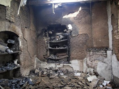Burnt rooms inside a prison are seen following a Taliban attack in Dera Ismail Khan July 30, 2013. Taliban fighters disguised as police and