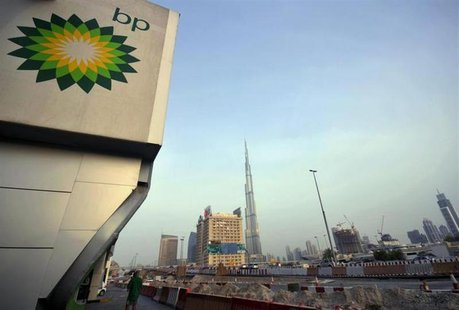 The British Petroleum logo is seen near a petrol station in Dubai with the Burj Khalifa tower in the background July 7, 2010. REUTERS/Jumana