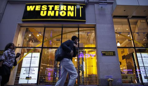 People walk past a Western Union branch at Times Square in New York November 30, 2011. REUTERS/Eduardo Munoz