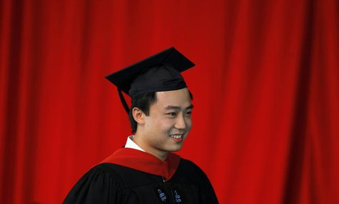 Bo Guagua, son of fallen Chinese politician Bo Xilai, walks offstage after receiving his masters degree in public policy at the John F. Kenn