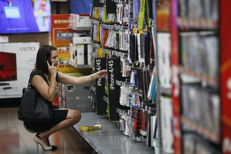 A woman shops at a Walmart Supercenter in Rogers, Arkansas June 6, 2013. REUTERS/Rick Wilking