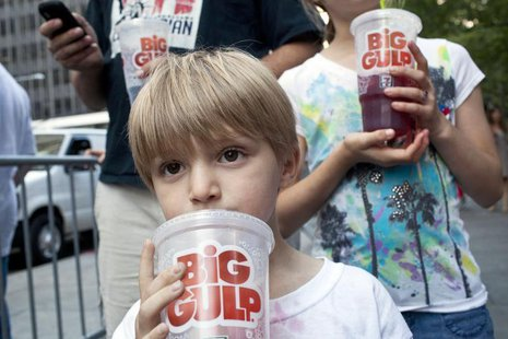 "Benjamin Lesczynski, 8, of New York, takes a sip of a ""Big Gulp"" while protesting the proposed ""soda-ban,"" that New York City Mayor Michael"