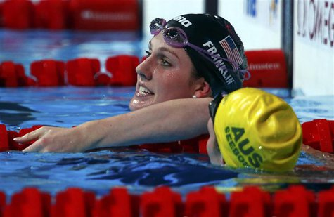 Missy Franklin of the U.S. (L) reacts beside Australia's Emily Seebohm after winning the women's 100m backstroke final during the World Swim