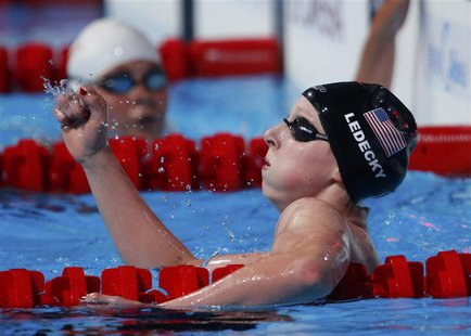 Katie Ledecky of the U.S. celebrates after setting a new world record to win the women's 1500m freestyle final during the World Swimming Cha