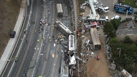 An overhead view of the wreckage of a train crash is seen near Santiago de Compostela, northwestern Spain, in this still image from video, J