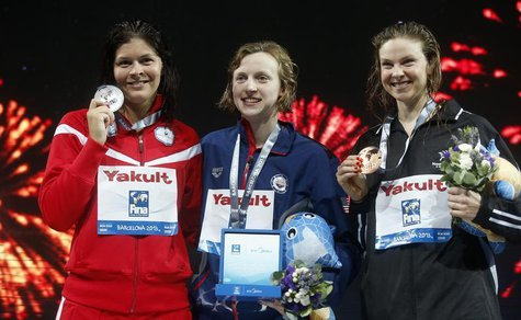 Gold medalist Katie Ledecky of the U.S. (C) poses with other medalists at the women's 1500m freestyle victory ceremony during the World Swim