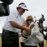Phil Mickelson of the U.S. (L) holds the Claret Jug as he celebrates with his wife Amy after winning the British Open golf championship at M