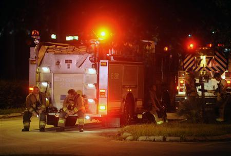 Lake County fire-fighters rest after working to extinguish a fire at the remains of a propane plant after massive explosions at the plant in Tavares, Florida July 30, 2013. Credit: Reuters/David Manning