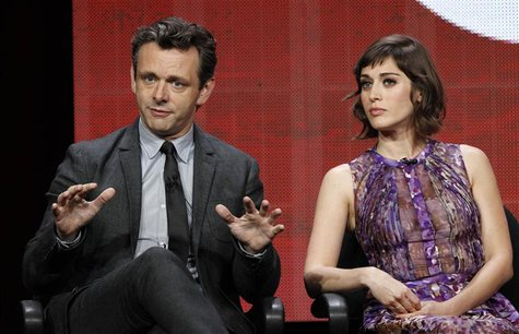 "Cast member Michael Sheen speaks next to co-star Lizzy Caplan at a panel for the television series ""Masters of Sex"" during the Showtime port"