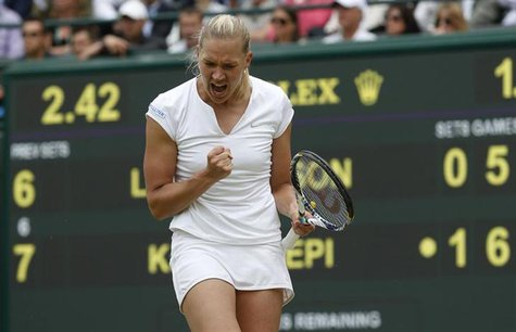 Kaia Kanepi of Estonia celebrates after defeating Laura Robson of Britain in their women's singles tennis match at the Wimbledon Tennis Cham