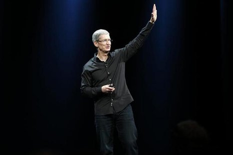 Apple Inc. CEO Tim Cook waves to the crowd during the Apple Worldwide Developers Conference (WWDC) 2013 in San Francisco, California June 10