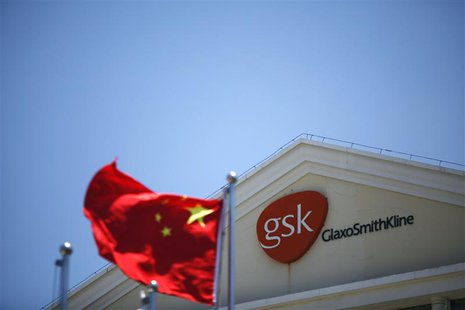 A Chinese national flag flutters in front of a GlaxoSmithKline (GSK) office building in Shanghai, in this July 12, 2013 file photo. The dete