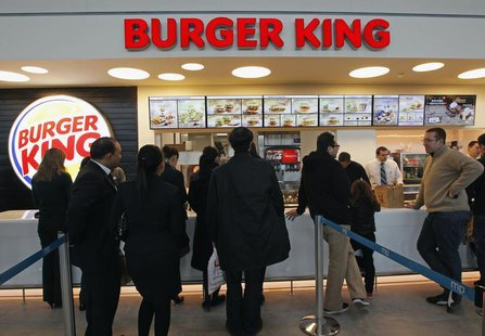 Customers queue up on the opening day of the Burger King restaurant at the Marignane airport hall December 22, 2012. REUTERS/Jean-Paul Pelis