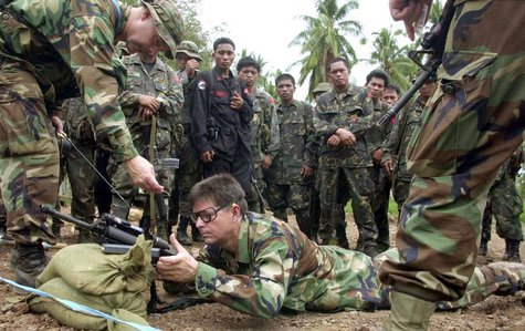 American special forces soldiers show Filipino army troopers techniques in firing their rifles during marksmanship training at a firing rang