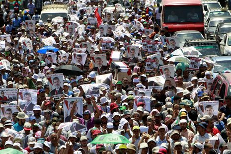 Supporters of deposed Egyptian President Mohamed Mursi shout slogans and hold symbolic coffins during a march from the Al-Fath Mosque to the