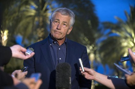 U.S. Secretary of Defense Chuck Hagel speaks with reporters after reading a statement on chemical weapon use in Syria during a news conferen