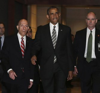 U.S. President Barack Obama (C) arrives for a meeting with House Democrats at the Capitol Visitor's Center in Washington July 31, 2013. REUT