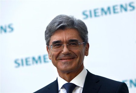Newly elected Siemens CEO Joe Kaeser arrives for a news conference in Germany's Siemens AG headquarter in Munich July 31, 2013. REUTERS/Mich