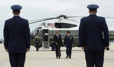 U.S. President Barack Obama (C) departs Joint Base Andrews in Maryland September 4, 2012, for a campaign trip to Norfolk, Virginia. REUTERS/