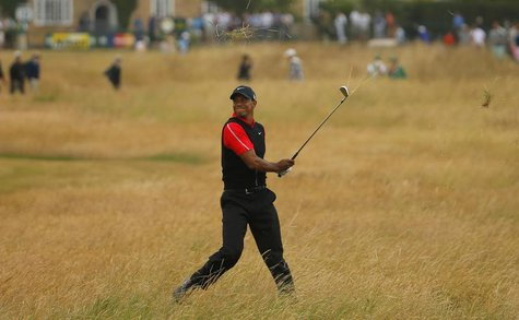 Tiger Woods of the U.S. hits out of the rough on the tenth hole during the final round of the British Open golf championship at Muirfield in