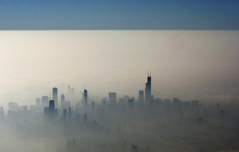 Blue sky is seen over a blanket of fog enveloping the skyline of Chicago, as photographed from an airplane window November 21, 2012. REUTERS