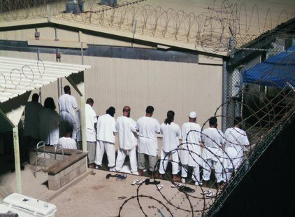 Detainees participate in an early morning prayer session at Camp IV at the detention facility in Guantanamo Bay U.S. Naval Base August 5, 20