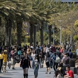 Students walk through campus between classes at Santa Monica College in Santa Monica, California April 4, 2012. REUTERS/Bret Hartman