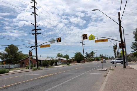 High-intensity Activated Crosswalk(HAWK) signal installation near a school in Tucson, Ariz. (courtesy www.pedbikeimages.org / Sree Gajula)