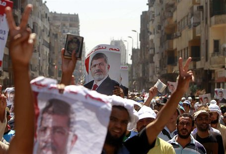 Supporters of deposed Egyptian President Mohamed Mursi shout slogans during a march from Al-Fath Mosque to the defence ministry, in Cairo Ju