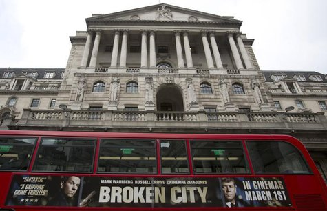 A bus passes the Bank of England in the City of London February 23, 2013. REUTERS/Neil Hall