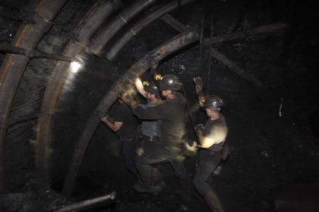 A group of miners secure a wall inside of an excavation corridor at Zofiowka coal mine of the JSW coal mine company, in Jastrzebie Zdroj, so
