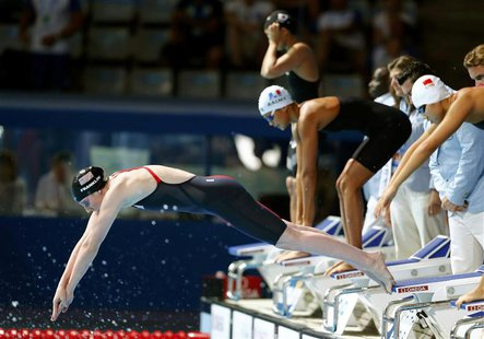 Missy Franklin of the U.S. dives in the women's 4x200m freestyle final during the World Swimming Championships at the Sant Jordi arena in Ba