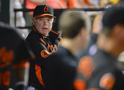Baltimore Orioles manager Buck Showalter talks to one of his players during their MLB American League baseball game with the Toronto Blue Ja