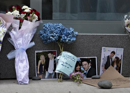 Flowers and photos are left at a small memorial for Canadian actor Cory Monteith outside a downtown hotel in Vancouver, British Columbia Jul