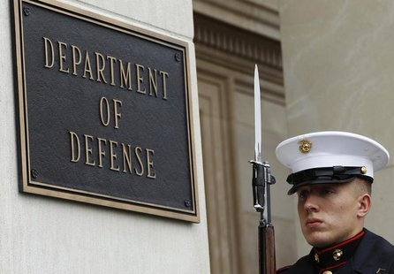 A U.S. Marine, who is part of a military honor guard, takes his position at the Pentagon in Washington April 30, 2013. REUTERS/Gary Cameron