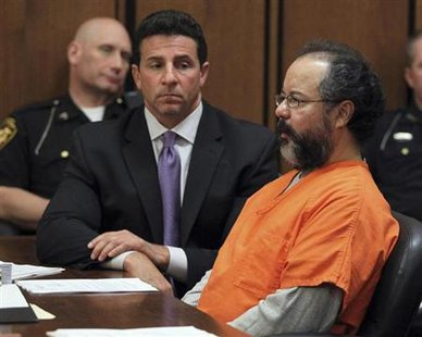 Ariel Castro (R), 53, sits in the court room next to his attorney Craig Weintraub in Cleveland, Ohio July 26, 2013. Credit: Reuters/Aaron Josefczyk
