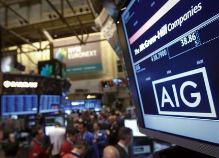 The American International Group, Inc. (AIG) stock ticker is seen on a monitor as traders work on the floor of the New York Stock Exchange a