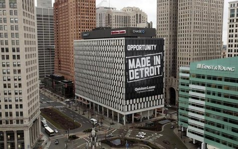 A view of downtown Detroit is seen looking south on Woodward Avenue including one of several buildings (with the Made In Detroit banner) rec
