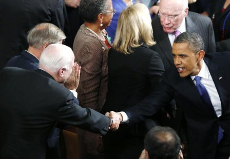 U.S. President Barack Obama (R) shakes hands with U.S. Sen. John McCain (R-AZ) as he arrives to deliver his State of the Union Speech on Cap