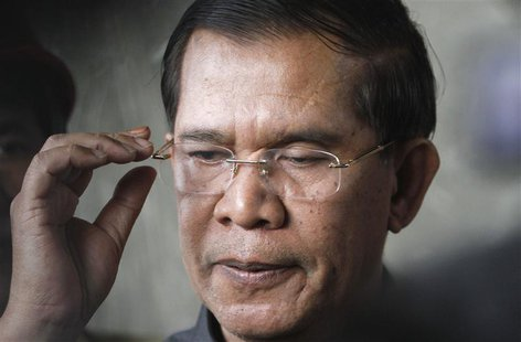 Cambodia's Prime Minister Hun Sen reacts as he speaks to the media during an inspection of a bridge construction site in Phnom Penh July 31,