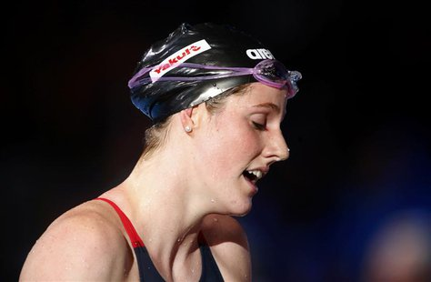 Winner Missy Franklin of the U.S. reacts after the women's 200m freestyle final during the World Swimming Championships at the Sant Jordi ar