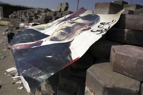 A poster of deposed Egyptian President Mohamed Mursi is seen on bricks placed throughout the camp, at the entrance to their campsite near th