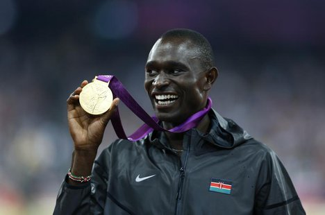 Gold medallist David Lekuta Rudisha of Kenya shows his medal during the presentation ceremony for the men's 800m event at the London 2012 Ol